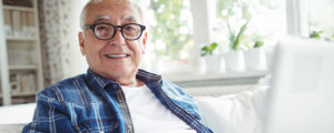 Elderly man smiling with dentures