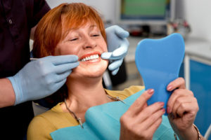 Woman getting fitted for new dentures